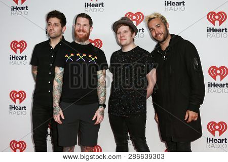 LAS VEGAS-SEP 19: (L-R) Joe Trohman, Andy Hurley, Patrick Stump & Pete Wentz of Fall Out Boy at the 2015 iHeartRadio Music Festival at MGM Grand Night 2 on September 19, 2015 in Las Vegas, Nevada.