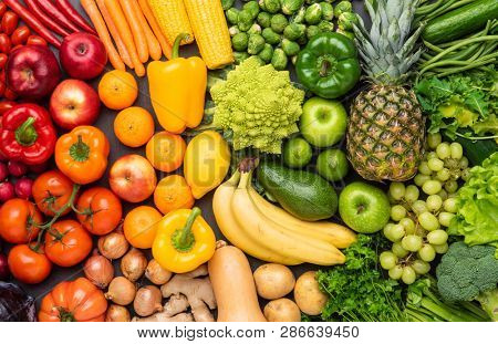 Healthy eating ingredients: fresh vegetables, fruits and superfood. Nutrition, diet, vegan food concept