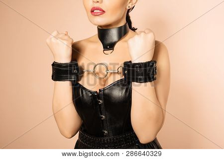 Submissive Girl In Leather Black Corset, Handcuffs And Collar Waiting For Punishment. - Image