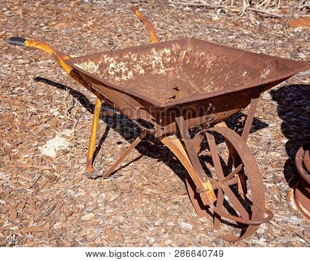 Rusted Old Vintage Wheelbarrow Disused And Abandoned