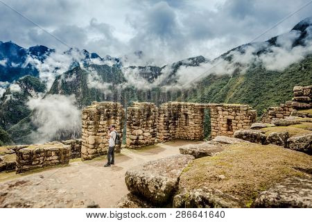 Pillars of incas architecture in front of majestic view of Machu Picchu