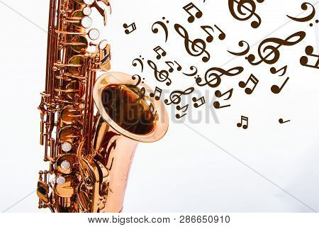 Copper Saxophone With Black Notes And White Background