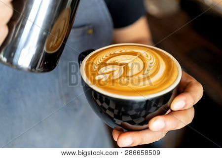 Closeup Image Of Male Hands Barista Pouring Milk  Make  Coffee Latte Art In Coffee Shop Cafe