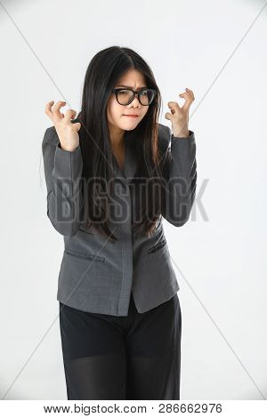 Half-length Studio Portrait Of Young Asian Woman, Long Black Hair, Wearing Glasses, In Gray Suit, Ho
