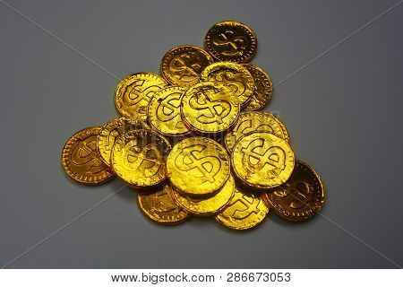 Sweet Chocolates Are In The Form Of Gold Coins. Gold Cents With A Beautiful Overflow And Gold Reflec