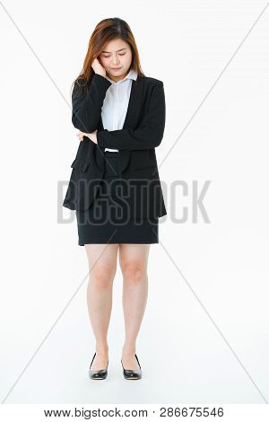 Full Length Studio Portrait Of Young, Beautiful, Attractive Asian Lady, In Business Suit, Worried Fa