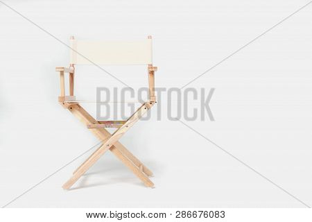 Director Chair Made Of Wood And Fabric Well Comfortable Sitting On A White Backdrop, Copy Space