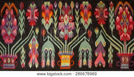Crafts. Woven Wool Carpet. Folk Art.close Up Of Geometric Patterned Carpet. Hand Woven Rug With Red,