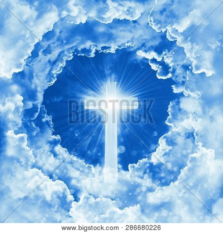 Concept Of Christian Religion Shining Cross On The Background Of Dramatic Cloudy Sky. Sky With Cross