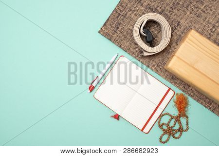 Top View Of Yoga Accessories And Notebook For Writing. Yoga Teaching Course