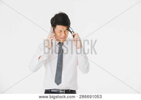 Close Up Portrait Of Middle Aged, Handsome, Asian, Businessman, In White Shirt, Striped Tie Posing,