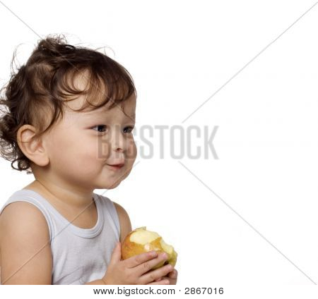 The Child Eats A Apple.