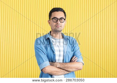 Front View, Close-up Portrait Of Young Asian Handsome Bearded Man, Wearing Eyeglasses, In Denim Shir
