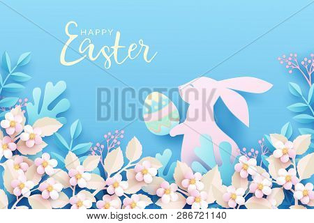 Happy Easter Festive Background. Cute Bunny In Spring Nature Holds An Easter Egg In Its Paws. Easter