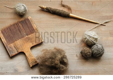 Ancient Female Craft Tools On Brown Wooden Background