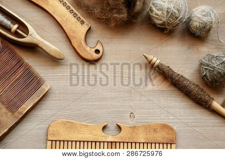 Traditional Female Craft Instruments On Brown Wooden Background