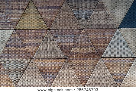 Wicker Of Rattan Woven Background Texture. Wall From Triangle Shape Rattan Or Bamboo Is A Traditiona