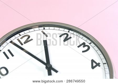 Part Of Wall Clock On Pink Background