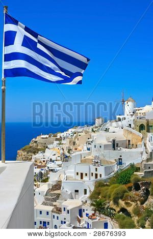 Beautiful Oia Windmill With National Flag Of Greece