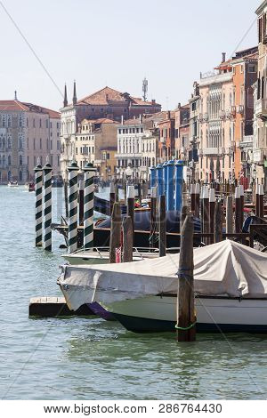 Venice, Italy - September 22, 2017: Grand Canal, Vintage Buildings, Parked Boats At The Marina. Cana