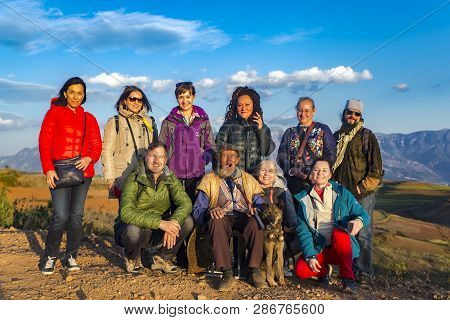 China, Dongchuan, Yunnan Province, November, 11, 2018 - Group Of Travelers With Elderly And Cheerful