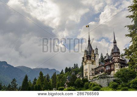 Peles castle and ornamental garden in Sinaia landmark of Carpathian mountains poster