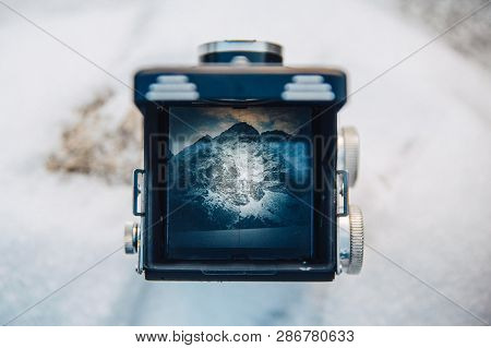 View On The Mountain Scenery Through The Viewfinder Of The Old Camera Photo. Photographer Of The Old