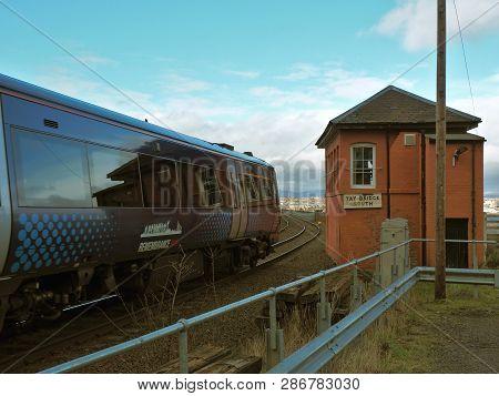Railway Bridge In Dundee.  Dundee, Scotland - February 20, 2019 Blurred Motion Passenger Train On Th