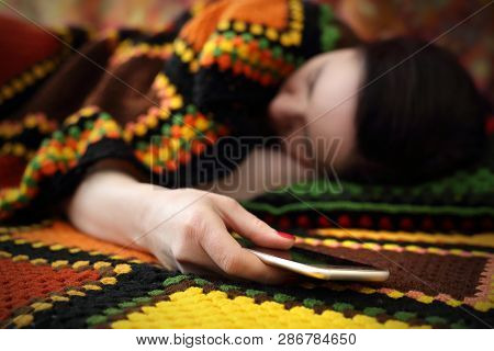 Illness Of The 21st Century, Addiction To Technology. A Woman Is Sleeping While Holding A Phone In H