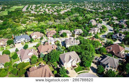 Aerial Drone View Above Houses And Rooftops Of Suburbia Neighborhood Near Cedar Park , Texas New Dev