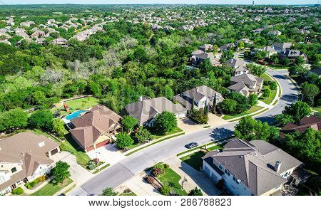 Suburb Neighborhood Cedar Park , Texas Aerial Drone View Above Texas Hill Country Homes On A Curved