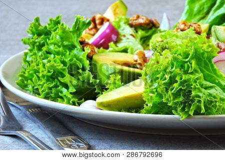 Salad With Avocado, Blue Onion And Walnut. Super Nutritious Fitness Salad With Avocado. Vegan Salad.