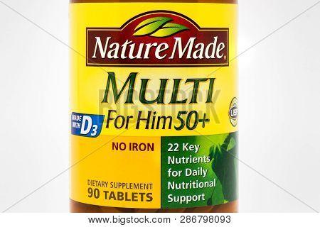 Nature Made Vitamin Bottle And Trademark Logo
