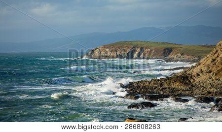 Panorama of waves crashing on the California coast near San Francisco.