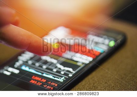 Businessman Use Smartphone Trading Online Forex Or Stock Exchange Market Board Data Screen Mobile Wi