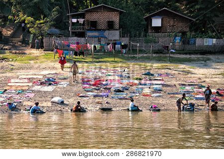 Mingun, Myanmar - November 25: People From Mingun Washing And Drying Clothes In The Traditional Way