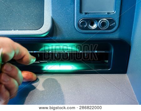Male Hand Waiting For Money From The Withdrawal Slot Of Modern Atm Automatic Teller Machine With Hea