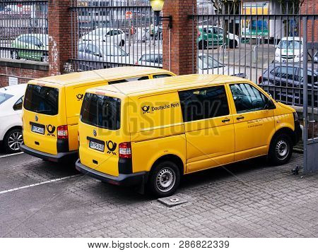 Hamburg, Germany - Mar 22, 2018: Two Deutsche Post  Dhl Vans From Above In Parking Of Postal Office