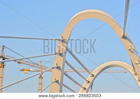Cables of cable-stayed bridge and construction cranes. Cable-stayed bridge Lazarevsky in St. Petersburg, Russia poster