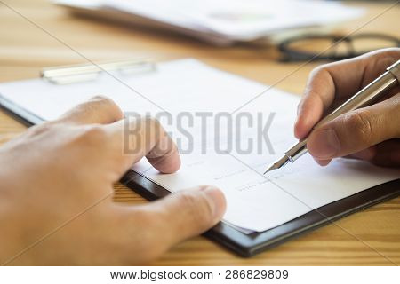 Business Man Signing A Contract. Owns The Business Sign Personally, Director Of The Company, Solicit