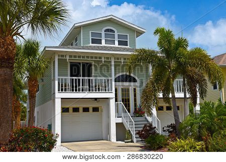 Large Beach House With Deck, Garages And Beautiful Landscaping Including Palm Trees