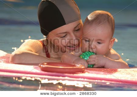 Baby With Mother In  The Water