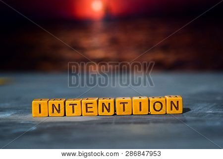 Intention On Wooden Blocks. Cross Processed Image With Bokeh Background