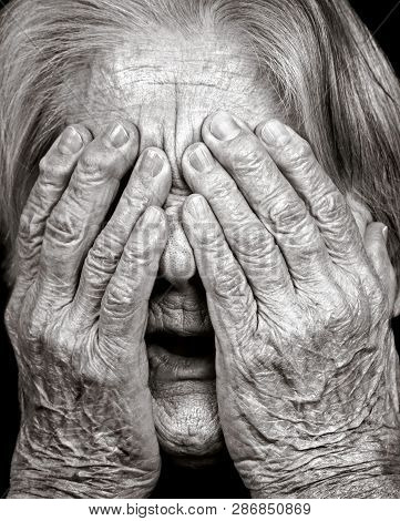 Close-up Portrait Of Old Woman Covering Her Face From Grief, Fear, Fright, Despair. Emotion Of Stres
