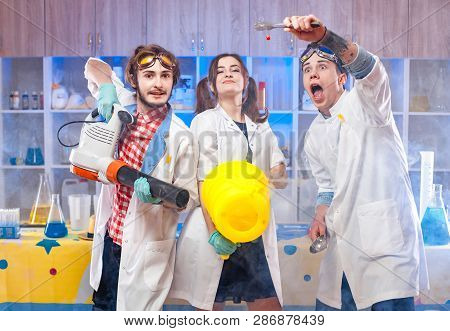 Funny Young Scientists Making Experiment In The Laboratory Together.