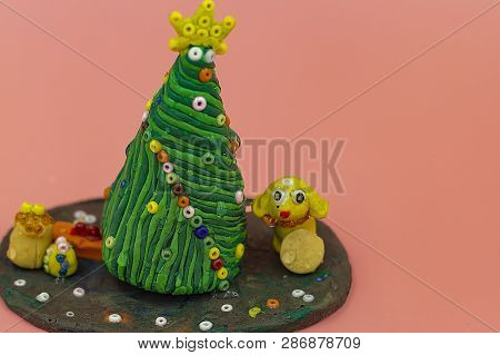 Childrens Crafts Made Of Plasticine-christmas Tree. The Year Of The Yellow Dog. Gifts Under The Tree