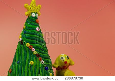 Childrens Crafts Made Of Plasticine-christmas Tree. The Year Of The Yellow Dog. Spiral Garlands Of B