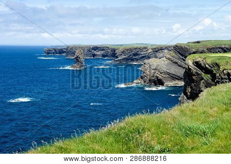 Cliffs Of Kilkee In Co. Clare, Ireland. Peninsula In West Clare, Ireland. Famous Beach And Landscape