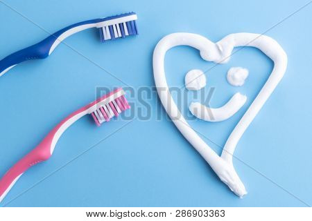 A Heart With Smiling Face Made Of White Toothpaste.white Toothpaste In A Shape Of A Heart With Smili