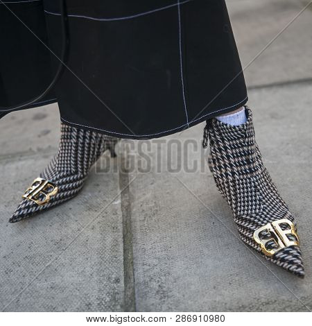 Stylish Attendees Gathering Outside 180 The Strand For London Fashion Week.